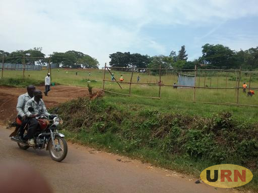 Workers fencing off part of Masaka Golf Course land.