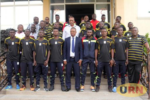 Fufa President Moses Magogo with the team before departure on Friday.