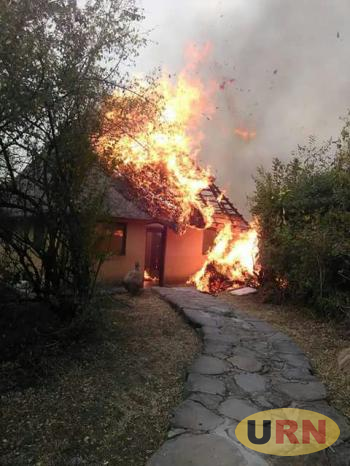 A cottage burning at Kyambura Game Lodge this evening