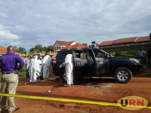 Forensics team from Uganda Police at the crime scene trying to do preliminary investigations