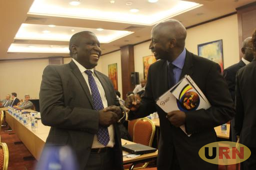 National Petroleum Authority Director, Earnest Rubondo chats with Tullow's Uganda MD, Jimmy Mugerwa