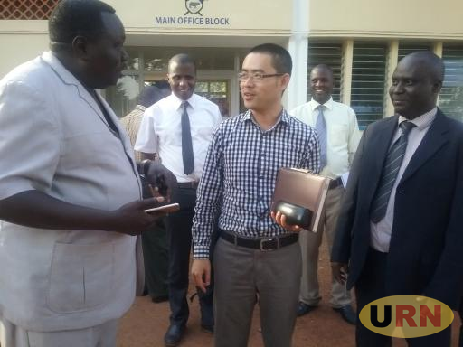 Lira Municipality Mayor Mike Ogwang Olwa Veve (Left) togther with the Town Clerk Assy Abirebe (Right) share a moment with Duan Yangchun, the Deputy Country Director of CICO