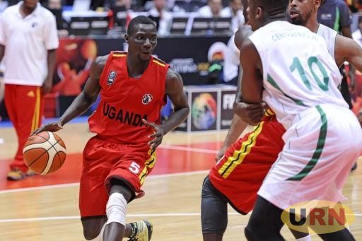 Uganda Guard Jimmy Enabu, drives past the Central African Republic in a 2015 game