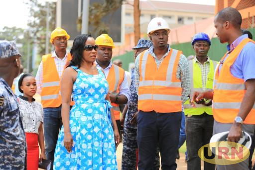 Jennifer Musisi, the KCCA Executive Director touring roads under construction in Kampala.
