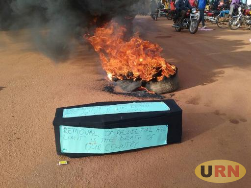 Demonstrators Lit a Huge Fire in the Middle of the road in Lira townand place a coffin near it on Thursday to express their frastruation on the proposed remkval ofthe Presidential age limit