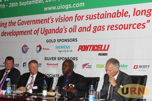 Dickens Kamugisha(3rd Left) and other discussannats about Uganda's Environment and Oil and gas developments.
