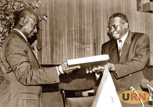 James Wapakhabulo (Right), the Chairperson of the Constituent Assembly, hands over the 1995 Constitution to President Yoweri Museveni in October 1995.