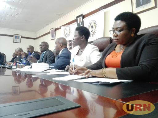 The electoral commissioners addressing the press today at the commission's headquarters in Kampala.