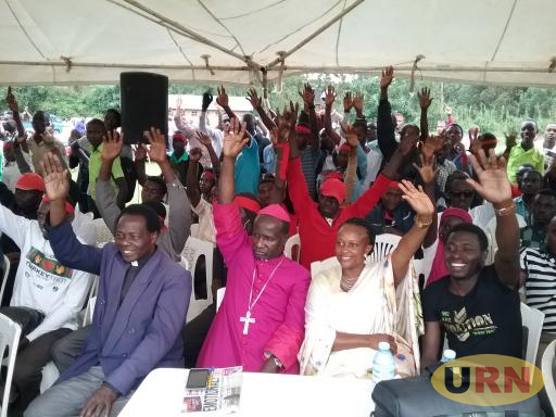 Bishop Robert Muhirwa and Kabarole district Woman MP Slyvia Rwabwogo show opposition to the removal of the age limit