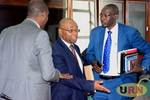 Igara West MP Raphael Magyezi storms out of parliament's legal committee with his seconders.