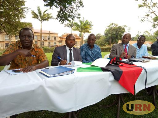 Makerere dons who are SoJNU members addressing media on age limit amendment