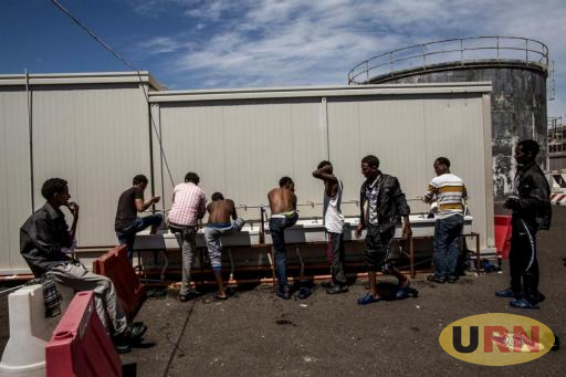 Eritrean refugees at a reception centre at the port of Augusta, Sicily, June 2015. They had been rescued at sea by the Spanish Coast Guard after setting out from Libya.