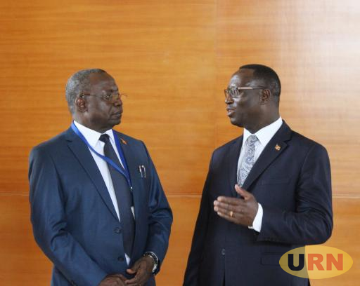 UNEB Secretary Dan Odongo and David Kibenge, an Undersecretary at the Ministry of Education.