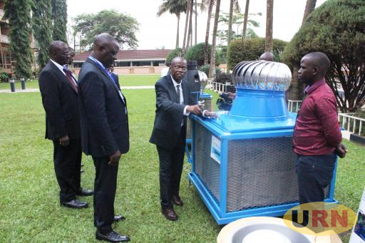 Prof. William Kasalita the project's Principal Investigator explaining how the Biogas-powered Evaporative Cooling works to State Minister for Agriculture Vincent Bamulangaki Ssempijja