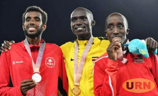 Joshua Kiprui Cheptegei (C) after receiving gold at the Gold Coast Commonwealth Games.oin