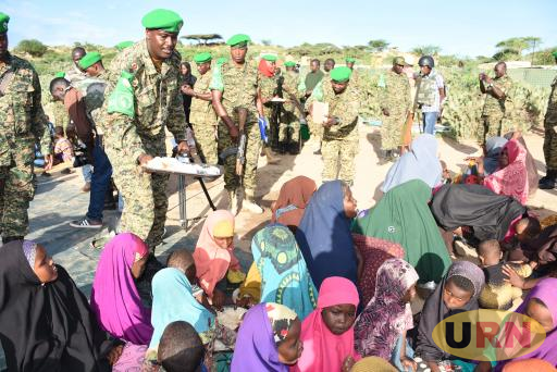 A UPDF serving food to Somali kids recently