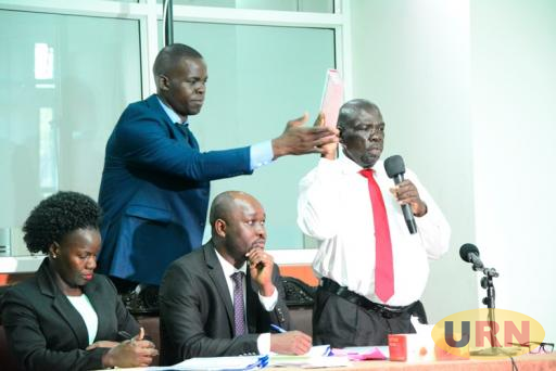 Zakali Baguma, the Commissioner Geological Survey Department in the Energy Ministry taking oath before the Land Probe.