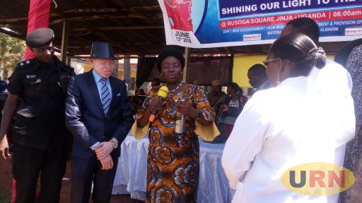 The speaker, Rt.Hon. Rebecca Kadaga(R) holds a cancer machine that was donated to people living with Albinism in Busoga sub region