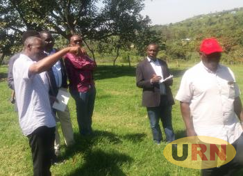 MPs with manager Nathan kabahigi (left) in the farm.