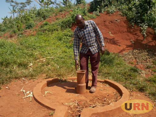 George Mutumba the chairman LC1 Katente village in Mukono standing near a bore hole that was vandalised