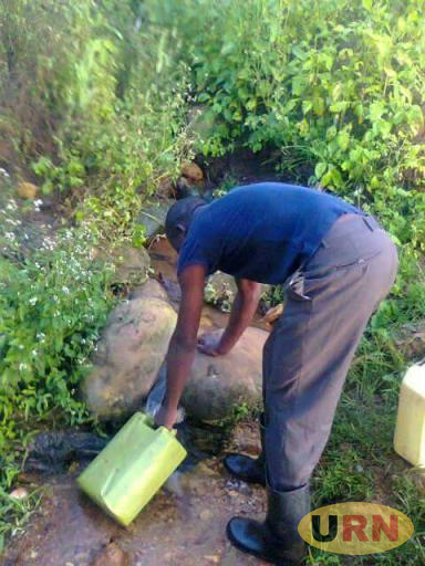 A man collecting water from a spring recently