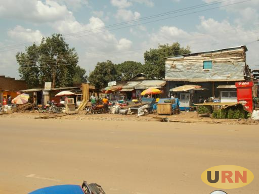 Roadside vendors at Nasuti trading center along Kayunga road