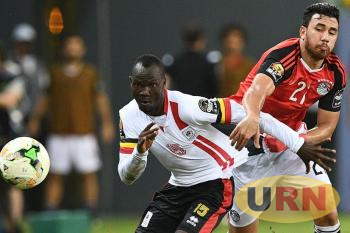Godfrey Walusimbi battling against an Egyptian player during the 2017 Africa Cup of Nations in Gabon.