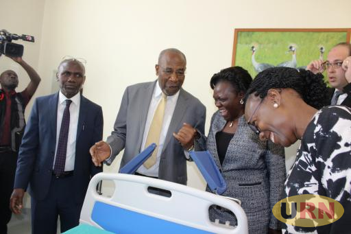 The Prime Minister Dr. Ruhakana and Health Minister, Jane Aceng check out one of the machines in the new facility