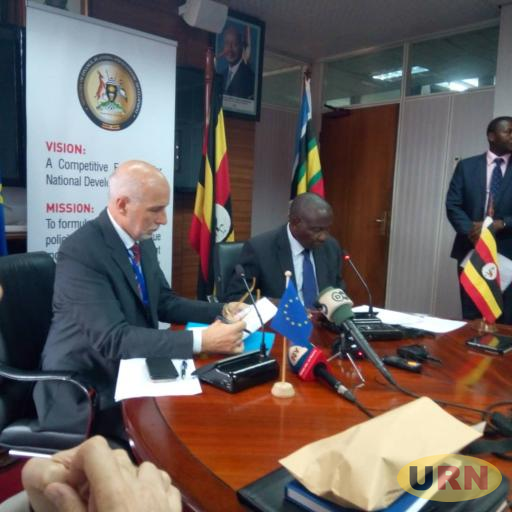 Head of EU mission in Uganda, Attilio Pacifici and Finance Minister Matia Kasaija  addressing journalists after singing the agreement