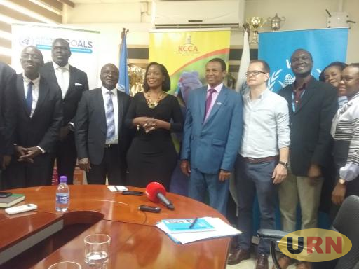 Musisi and Dalium pose with other officials from KCCA and WFP