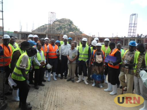 Soroti Municipal leaders led by the Mayor Soroti, Paul Omer visit the ongoing construction of Soroti Main Market together with officials from African Development Bank today in Soroti