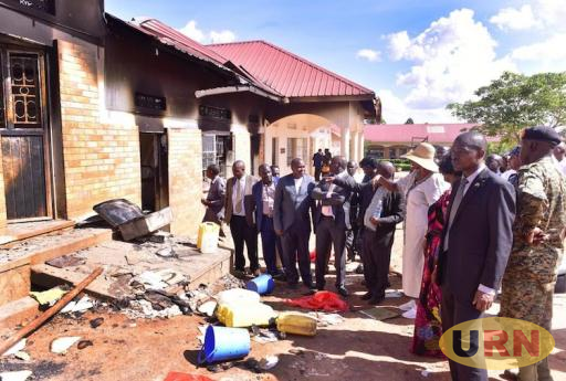 Minister of Education Janet Kataha Museveni tours the burnt dormitory