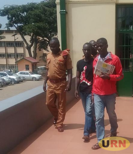 Gerald Kibuuka in a black t-shirt leaving the high court