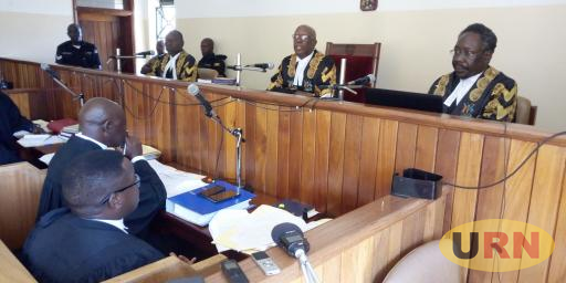 Court of Appeal Justices Christopher Izama Madrama (R) Kenneth Kakuru (C) and Ezekiel Muhanguzi (L) during the stakeholders' engagement at Arua high court on Monday.