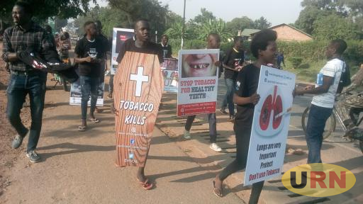 Youths marching on the streets of Arua town during the No tobacco, no smocking campaign on Thursday.
