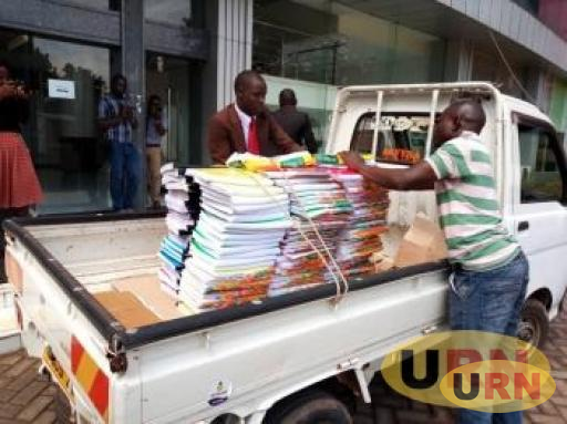 Male Mabirizi offloading some of his Documents at the Supreme Court in Kampala