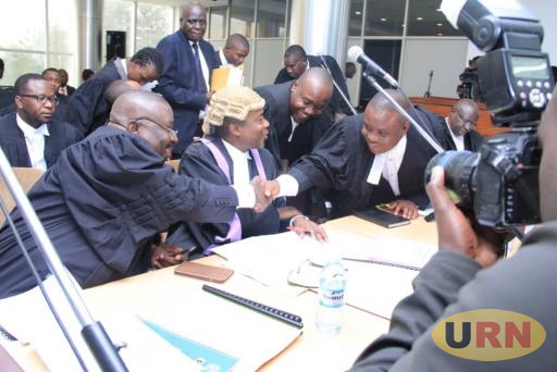 Lawyer of the Appellants Erias Lukwago Shaking hands with Deputy Attorney General Mwesigwa Rukutana as Attorney General William Byaruhanga Looks on in the Middle