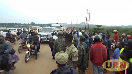 Police and army guiding traffic after controlling the fight between bodaboda riders