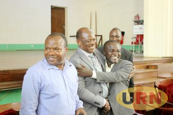 Makerere VC Prof. Barnabas Nawangwe hugs suspended MUASA leader Dr. Dues Kamunyu during a Joint Staff Assembly on Monday.