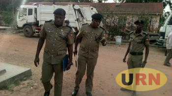 Abbas Senyonjo former DPC Arua and Jonathan Musinguzi former RPC West Nile being ushered by the OC station Arua in to the police disciplinary court at Arua Municipal council hall on Wednesday morning.