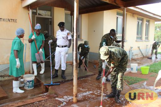 UPDF officers clean Jinja regional referral hospital on Wednesday.