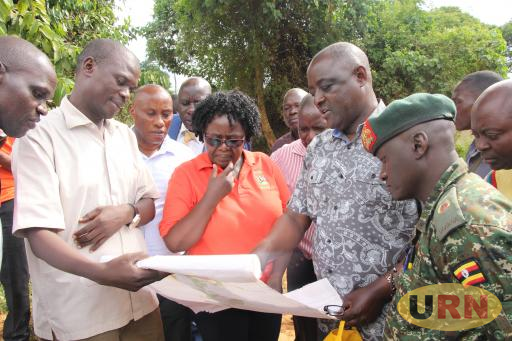 Vincent Bamulangaki Ssempijja, Cabinet minister for Agriculture, Animal industry and fisheries being shown the map of the land that has been acquired by VODP2