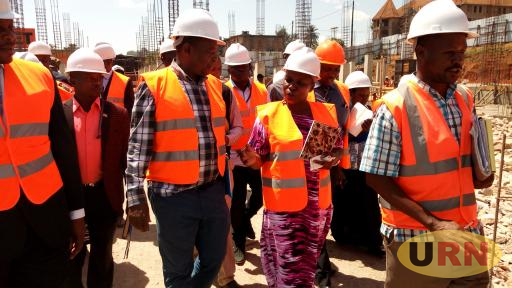 Local Government State Minister Janifer Namuyangu (C) inspecting Masaka market site where she clashed with contractors over delayed works.jpg