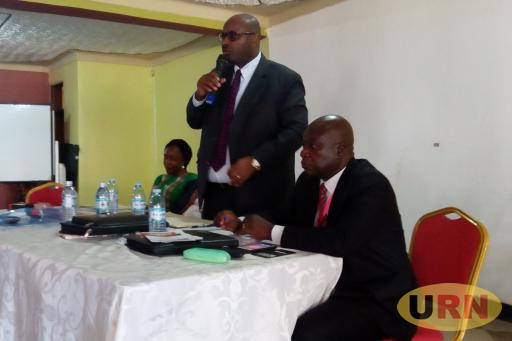 Benjamin Kumumanya the Permanent Secretary of Ministry of Local Government addressing CAOs at ALGAOU Annual General Meeting held at Nimrod Hotel in Luweero town