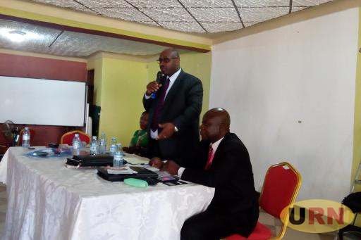 Benjamin Kumumanya the Permanent Secretary of Ministry of Local Government Ministry addressing CAOs at  ALGAOU Annual General Meeting held at Nimrod Hotel in Luweero town