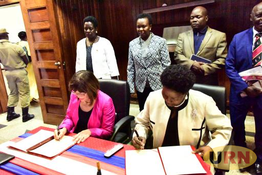 Speaker Rebecca Kadaga and her Serbian counterpart signing MOUs at parliament