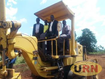 Kirungi Kadir, the Hoima district LC5 Chairperson Launching the road construction works.