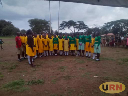 Pupils of Kasimeri Primary School singing against defilement during the day of African child in Moroto.