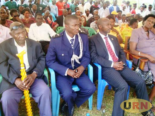 Mzee Sam Mwagalwa (extreme left) at a function with MP Ssekikuubo (in striped suit)