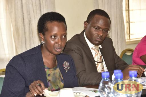Allen Kagina, Executive Director of UNRA appearing before the Physical Infrastructure committee. Looking is Charles Naita, the acting Director, Projects.